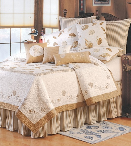 Embroidered sea shells and starfish surround the center panel print of this lovely quilt. The background is 100% cotton in bone white with taupe accents and border. The Euro shams and