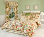 Blanchette- Over-flowing garden flowers typical of Antibellum southern plantations. Lavish bouquets of fragrant flowers in shades of red, yellow, blue, green and pink spill out onto the bone white background. Matching window curtains, valances pillows