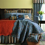 Wakefield Quilt - A Colonial Williamsburg® Foundation design of classic beauty. Richly colored ornate leaves, flowers and scrolling vines in shades of terracotta, burgundy and green on an indigo blue ground. A coordinate