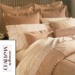 Sloane features magnificent embroidery on a silk like background in dusty peach. The duvet cover is fully embroidered and has a 100% cotton sheet fabric backing. Pillow shams and bedskirts are a coordinate pinstripe of the same color