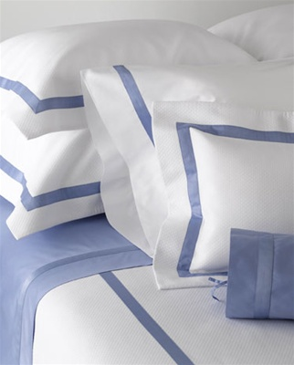 "Easy-care diamond pique embellished with a 1"" sateen tape detail.  Duvet covers and coverlets have a U shaped design on the top of the bed with a 3"" flanged border on three sides with taping."