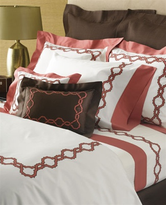 Arabesque chain applique' embellishes White Milano and Nocturne Coral sheeting and a Nocturne Chocolate boudoir pillow.