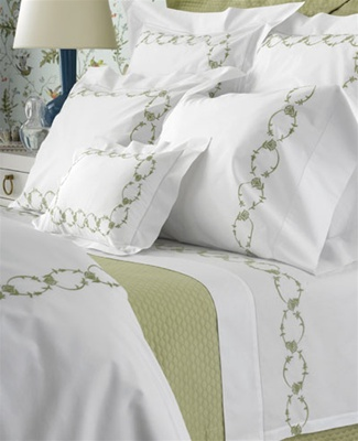 Annabelle scrolling vine embroidery bedecks White Milano sheeting with hemstitch detailing.