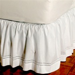 "Gathered Hemstitch - An intricate double hemstitch design. Bedskirts are machine washable, 100% cotton with split corners to accommodate footboards. Available in 14"", 18"" and 21"" heights.  These bedskirts can be used under print bedskirts to create stylis"