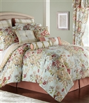Enhance your room with this elegant English floral. Beautiful multicolored floral bouquets of red, pale gold, taupe and green on a pale blue ground. The oversized comforter reverses to a quatrefoil design in pale gold.