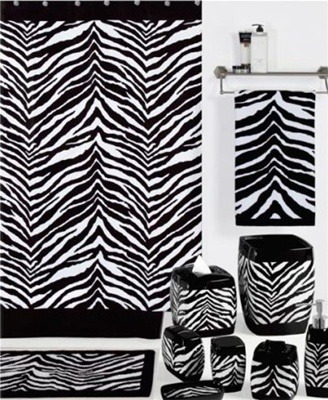 A striking black and white ensemble that will create an exotic look in any bathroom. The shower curtain is 100% polyester and is machine washable. Decorative accessories include ceramics with solid black borders around the top and bottoms of each piece.