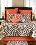 Expedition Quilt - Come on Safari with us with this fun ensemble of Zebra and Giraffe patterns. Rich shades of chocolate brown and apricot add a wonderful bold and refreshing look in any room. Decorative pillows include exotic skin looks.