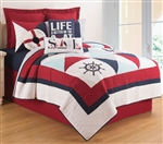 Original nautical theme quilt with detailed applique and embroidery. A crisp palette of navy and red and light blue on a cream background. Quilts are oversized for today¹s high profile mattresses.